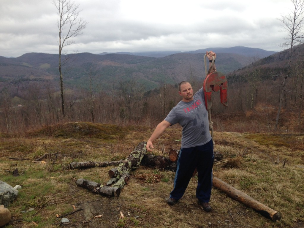 At the top of the mountain, where Death Race challenges are held, holding up a 70 lb Spartan Helmet!